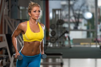 Portrait Of A Physically Fit Middle Age Womane In Fitness Center